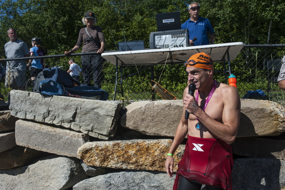 Scott Yeomans, the winner of Peaks to Portland, watches his fellow swimmers cross the finish line on Saturday at East End Beach.