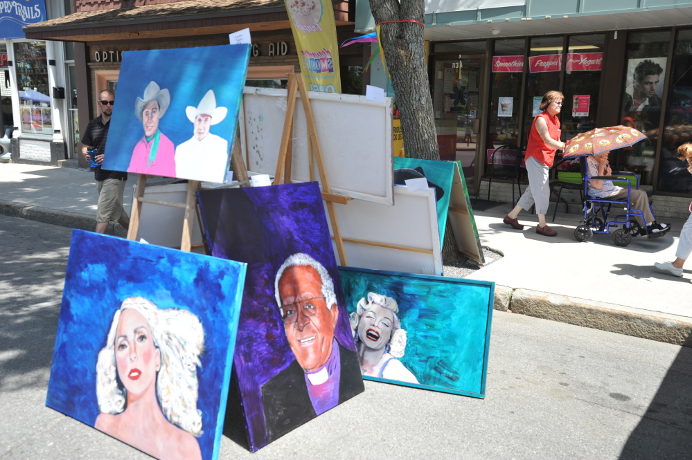Artwork stands on display on Main Street in Waterville during the art walk co-hosted by the Maine International Film Festival on Saturday.