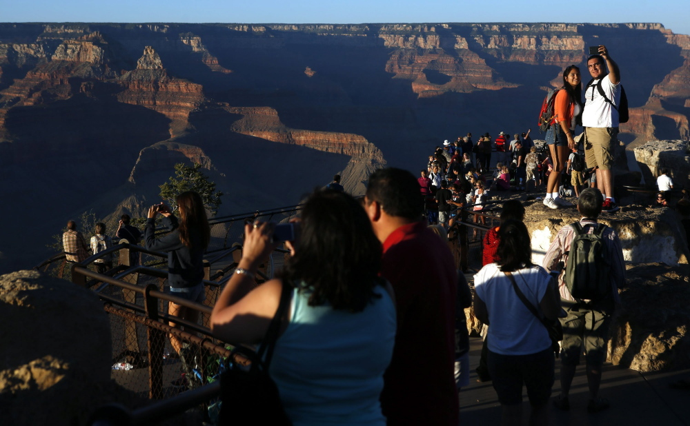 Visitors take in the view of the Grand Canyon at Mather Point on the Southern Rim of Grand Canyon National Park in January. The vista could be changed forever if developers build in this area.