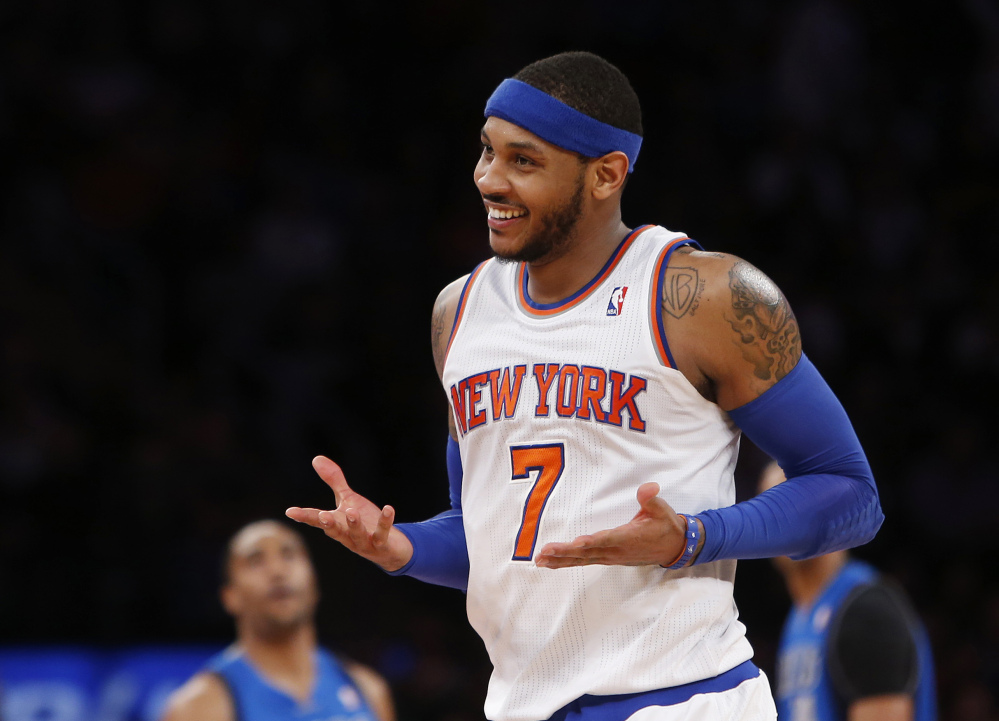 "Carmelo Anthony is remaining with the Knicks, saying he wants ""to stay and build here with this city and my team."" Anthony made his decision official Sunday with a posting on his website. He writes: ""In the end, I am a New York Knick at heart."""