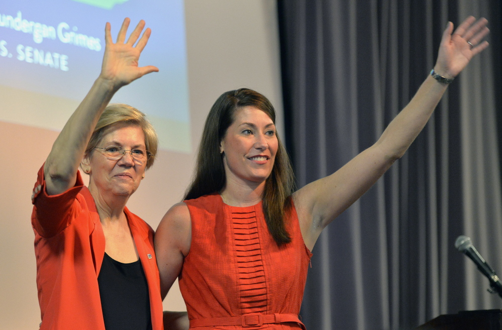 In Kentucky last month to support Democratic Senate candidate Alison Lundergan Grimes, right, U.S. Sen. Elizabeth Warren criticized Republicans for blocking legislation to let college graduates refinance their student loans at lower interest rates.