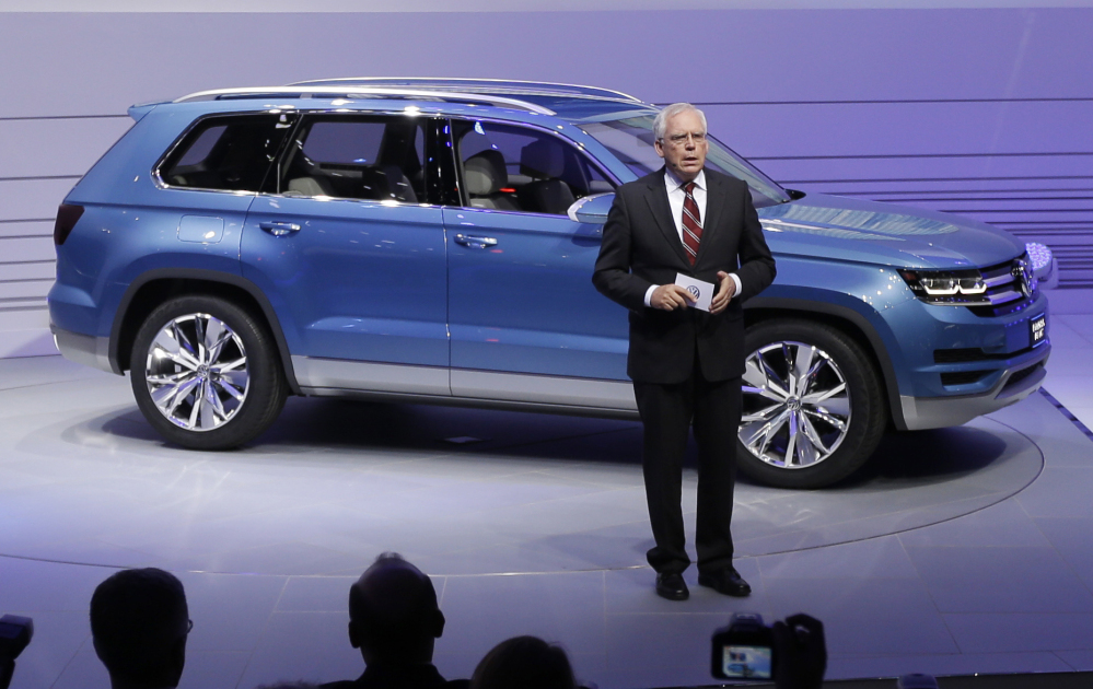 In this Jan. 14, 2013 file photo, Ulrich Hackenberg, Volkswagen Director of Produce Development for Power Trains, stands next to the Volkswagen CrossBlue SUV concept vehicle during the North American International Auto Show in Detroit.