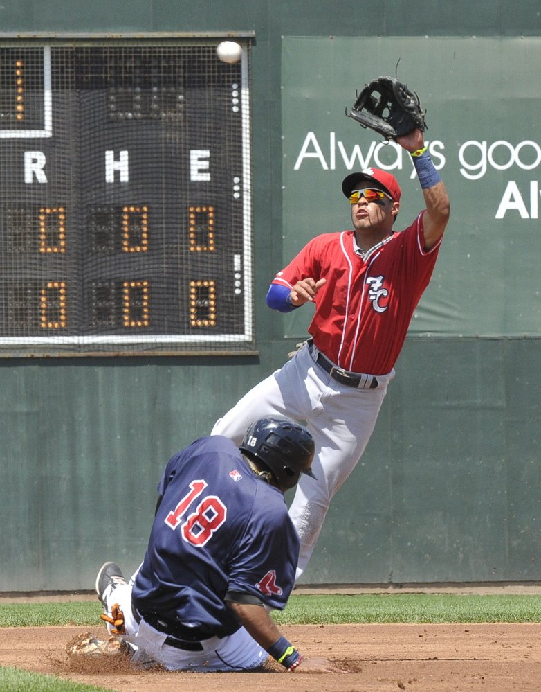 Michael Almanzar of the Portland Sea Dogs slides safely into second with a stolen base Monday as Jorge Flores of the New Hampshire Fisher Cats reaches for the throw during the Sea Dogs' 6-2 victory at Hadlock Field.