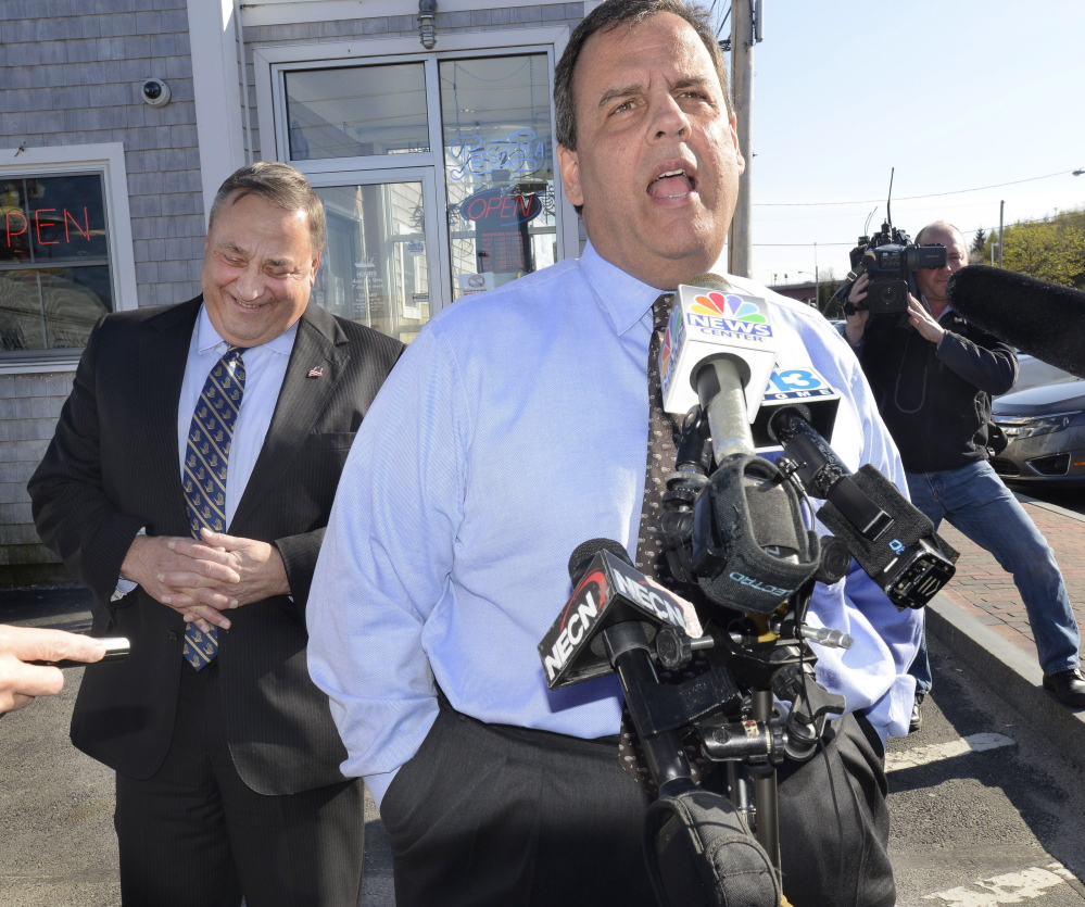 "Comments by New Jersey Gov. Chris Christie, the head of the Republican Governors Association, get a laugh from Gov. Paul LePage during a campaign stop in May at Becky's Diner in Portland.  ""We're going to be spending a lot of ... resources here,"" Christie said."