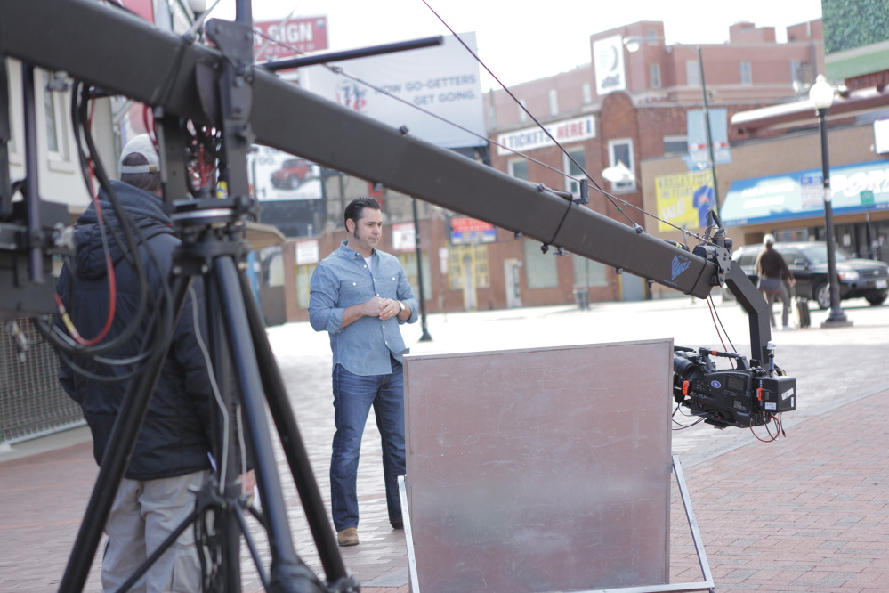 "Host David Guas takes a moment during a break in shooting for the Travel Channel's ""American Grilled."""