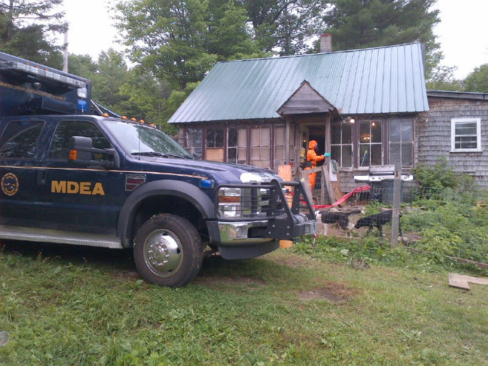 Members of the Maine Drug Enforcement Agency and Maine Department of Environmental Protection dismantle a suspected meth lab in Phillips on Tuesday.