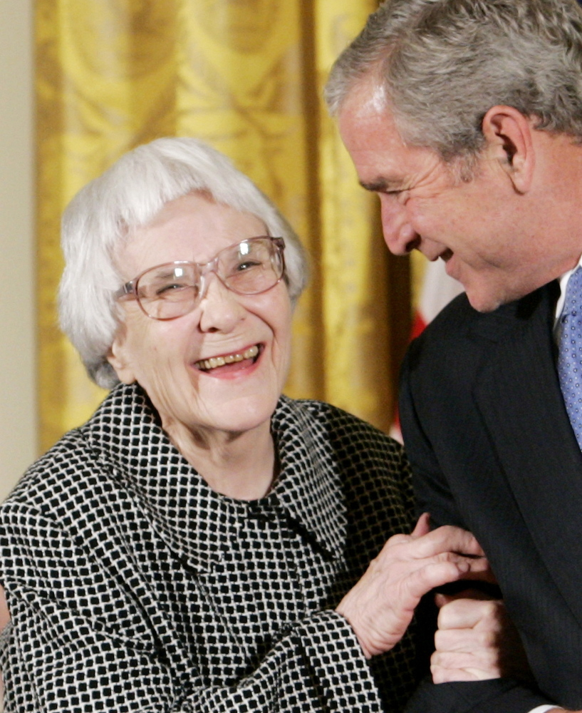 Former President George W. Bush, right, smiles before awarding the Presidential Medal of Freedom to American novelist Harper Lee in the East Room of the White House, on November 5, 2007.