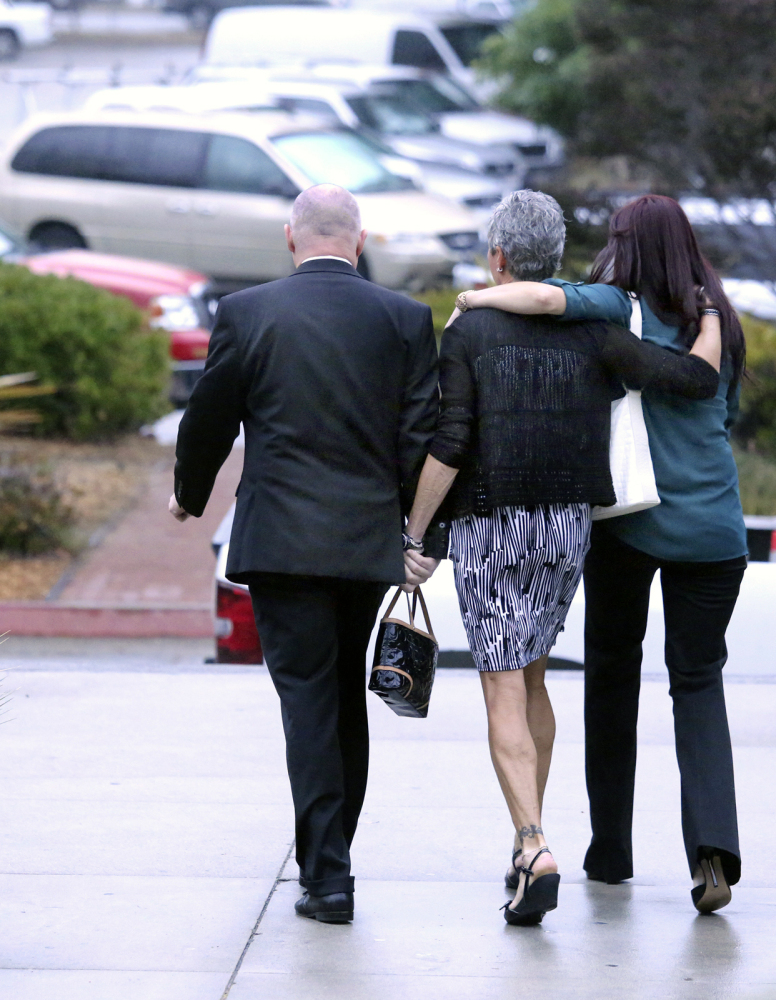 Alix Tichelman's parents, Bart and Leslie Tichelman, and her sister Monica Tichelman, right, leave Santa Cruz Superior Court after Alix Tichelmans's arraignment on Wednesday.