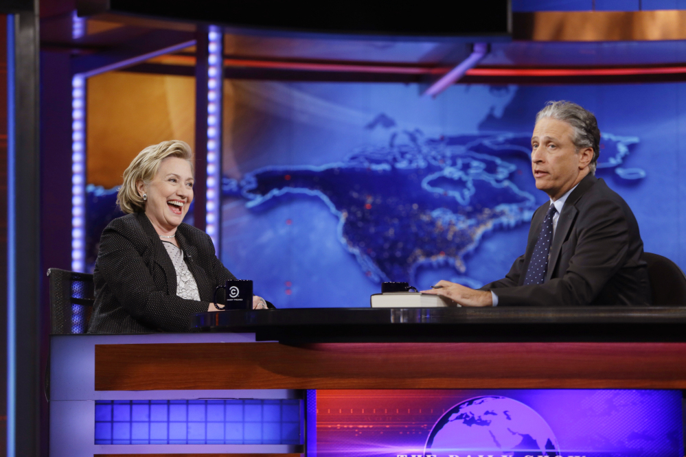 "Former U.S. Secretary of State Hillary Rodham Clinton reacts to host Jon Stewart during a taping of ""The Daily Show with Jon Stewart,"" Tuesday in New York"