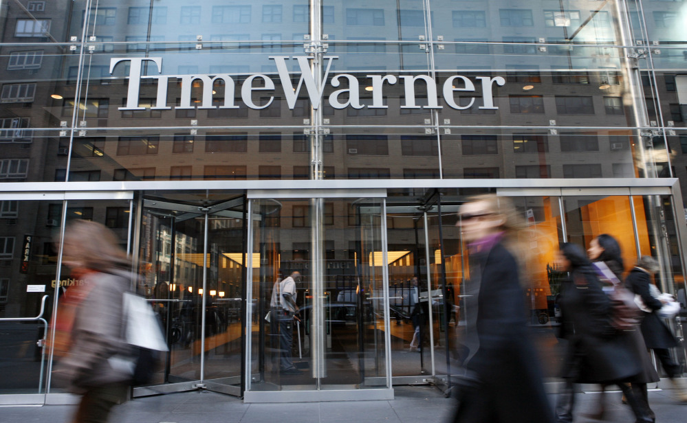In this Nov. 7, 2007 file photo, people walk by the Time Warner Center in New York.