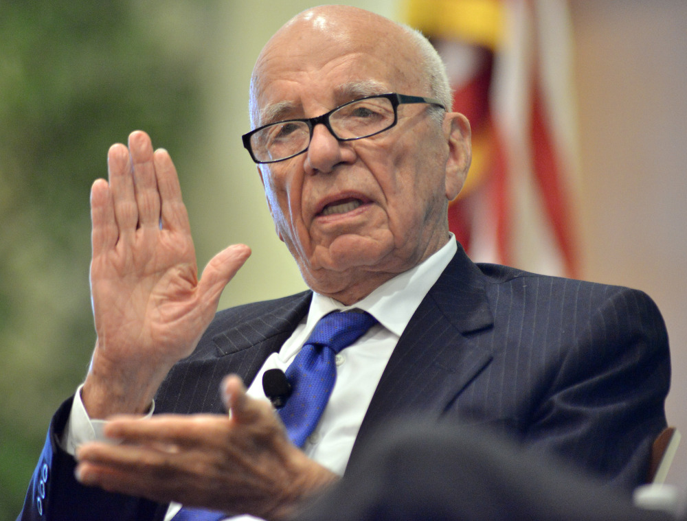 In this Aug. 14, 2012 file photo, News Corporation CEO Rupert Murdoch speaks during a forum on The Economics and Politics of Immigration in Boston.