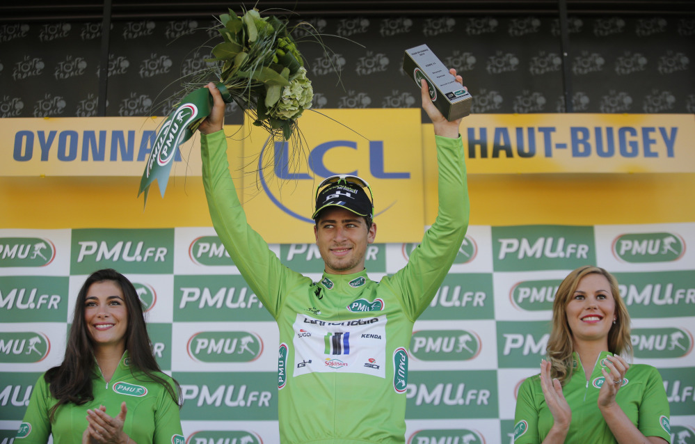 Peter Sagan of Slovakia, wearing the best sprinter's green jersey, celebrates on the podium of the eleventh stage of the Tour de France cycling race over 187.5 kilometers (116.5 miles) with start in Besancon and finish in Oyonnax, France, Wednesday.