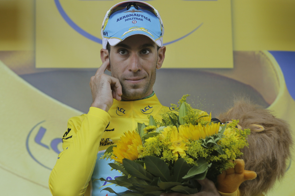 Italy's Vincenzo Nibali, wearing the overall leader's yellow jersey, celebrates Thursday after the 12th stage of the Tour de France. He says he expects to be questioned about performance enhancers but the sport has changed.