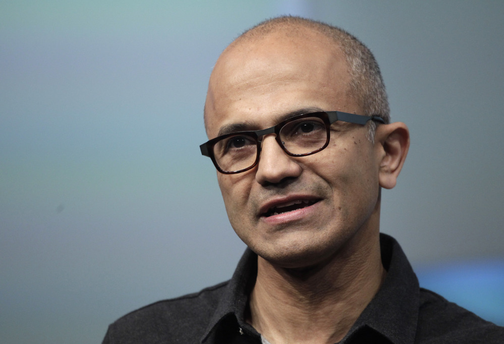 Microsoft CEO Satya Nadella talks during the introduction the Surface Pro 3 tablet device at a media preview in New York in May. Microsoft on Thursday announced it will lay off up to 18,000 workers over the next year.