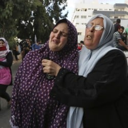 "The mother, left, of Fullah Tariq Shahebar, 8, one of three children who were killed in an Israeli missile strike, grieves after identifying her daughter at the hospital's morgue in Gaza City on Thursday. A State Department spokeswoman said, ""Israel must take every possible step to meet its standards for protecting civilians from being killed."""