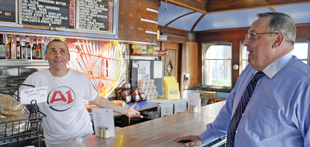 A-1 Diner proprietor Neil Andersen, left, confers with Gov. Paul Lepage on July 15 at the counter of the Gardiner restaurant. LePage made a campaign swing through the community and made unannounced visits at several businesses.