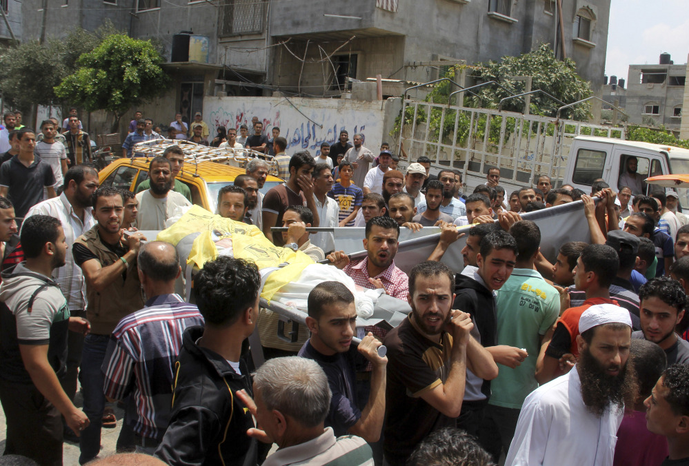 The Associated Press Palestinians carry the bodies of the brothers Hamza and Anas Abu Moamar, who were killed along with their brother, Mohammed Abu Moamar, at their family house in an airstrike, during their funeral in Rafah, in the southern Gaza Strip, on Sunday. The three brothers were killed early Sunday in Rafah by an airstrike, according to Gaza health ministry official Ashraf al-Kidra.