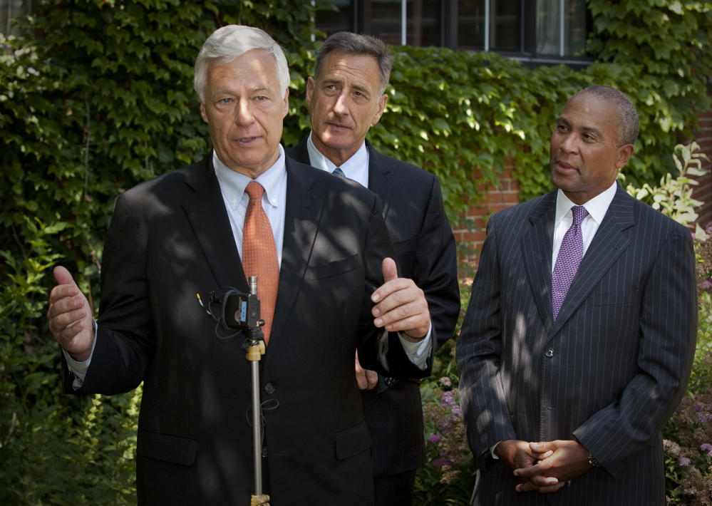 Maine Democratic candidate for governor, U.S. Rep. Mike Michaud, speaks during a news conference at the Cumberland Club in Portland on Monday. Gov. Peter Shumlin of Vermont, center, and Gov. Deval Patrick of Massachusetts, right, came to Maine to lend support.