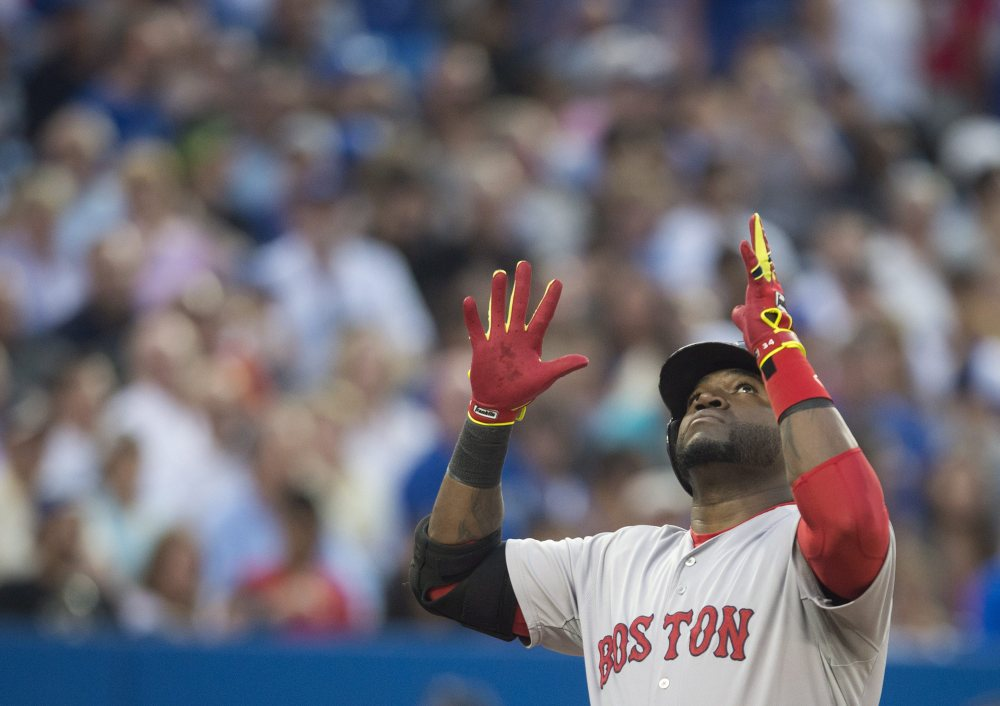 Boston Red Sox's David Ortiz celebrates his two-run home run in the fourth inning against the  Blue Jays in Toronto on Monday.