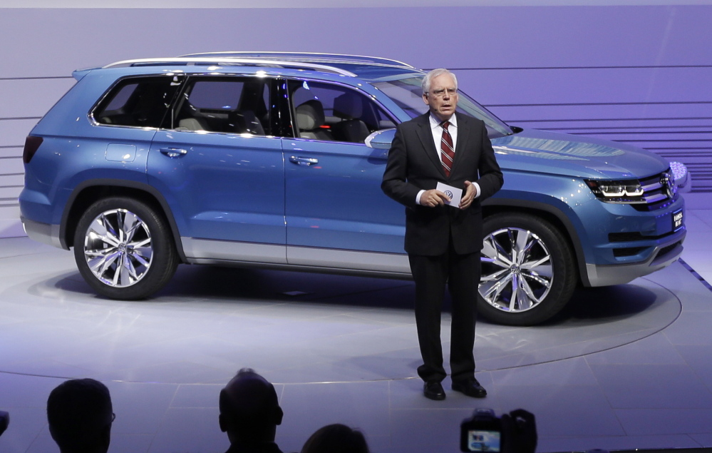 Volkswagen's Ulrich Hackenberg introduces a Volkswagen CrossBlue SUV concept vehicle in 2013. Automakers including Volkswagen and GM are enticing Americans with ads promising cheap leases.
