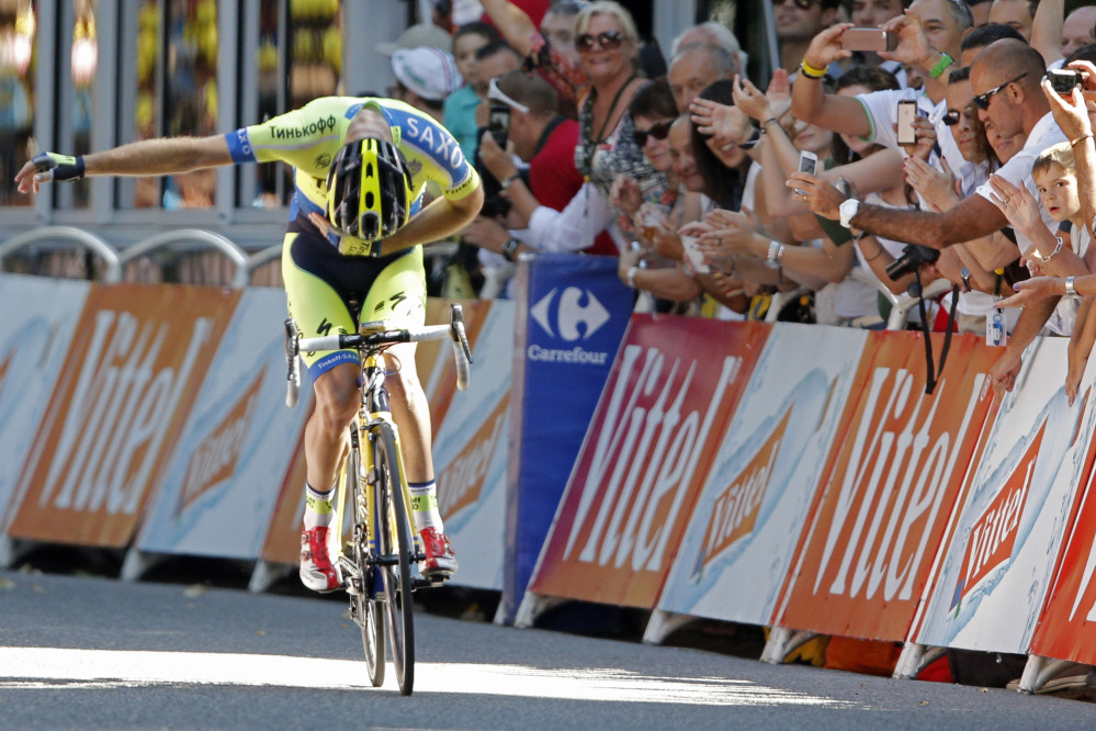 Australia's Michael Rogers bows for cheering spectators as he crosses the finish line to win the sixteenth stage of the Tour de France cycling race over 147 miles with start in Carcassonne and finish in Bagneres-de-Luchon, France, Tuesday.