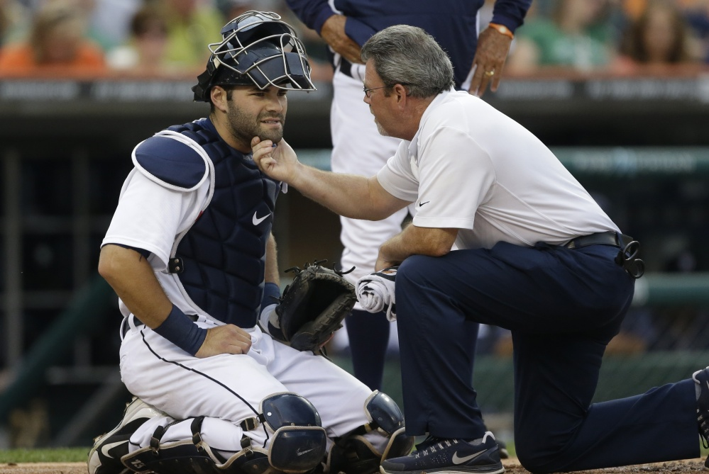 Catcher Alex Avila can keep his chin up thanks to the attention and expertise of Detroit Tigers trainer and Bowdoin College graduate Kevin Rand.