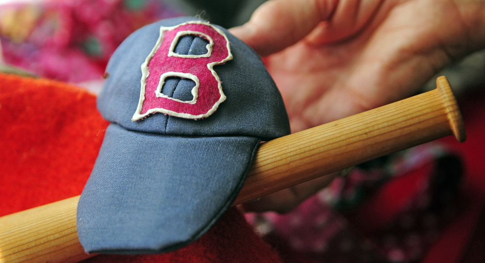 Marjorie Scott has over 100 outfits for Georgie the concrete goose, like these Red Sox accessories photographed on Wednesday in Augusta. She has been dressing it up for 20 years.