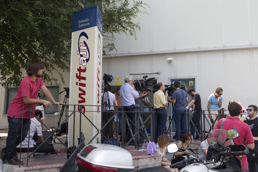 Journalists wait for news outside the Spanish Swiftair office in Madrid, Spain, Thursday. An Air Algerie flight carrying 116 people from Burkina Faso to Algeria's capital disappeared from radar early Thursday over northern Mali.
