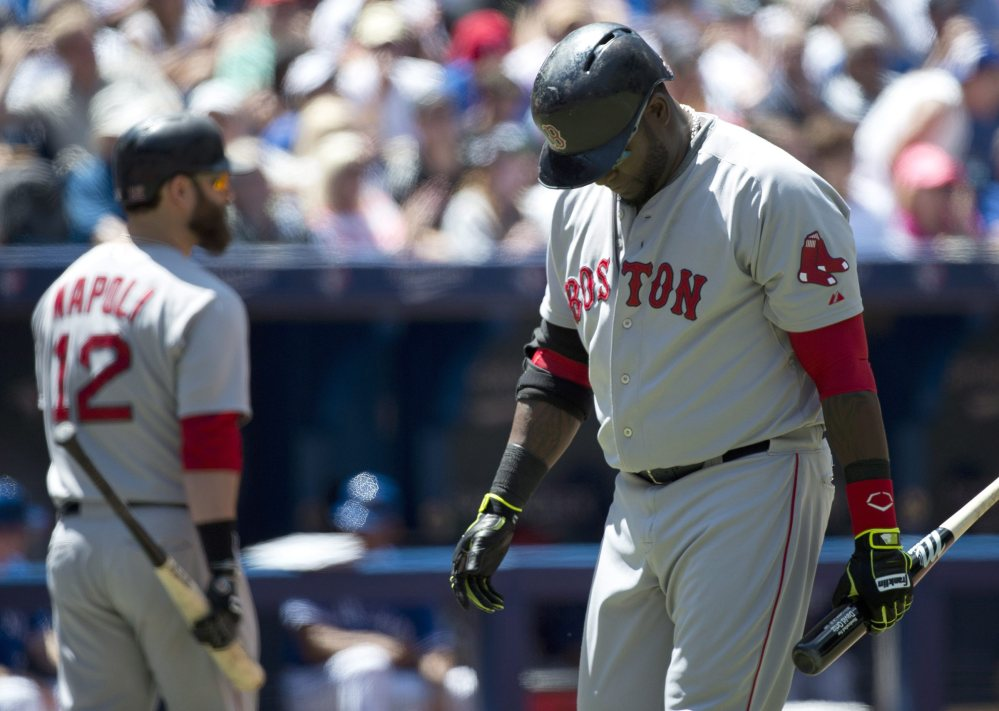 Boston Red Sox designated hitter David Ortiz looks down and makes his way back to the dugout after striking out against the Toronto Blue Jays in the fourth inning of Thursday's game in Toronto.