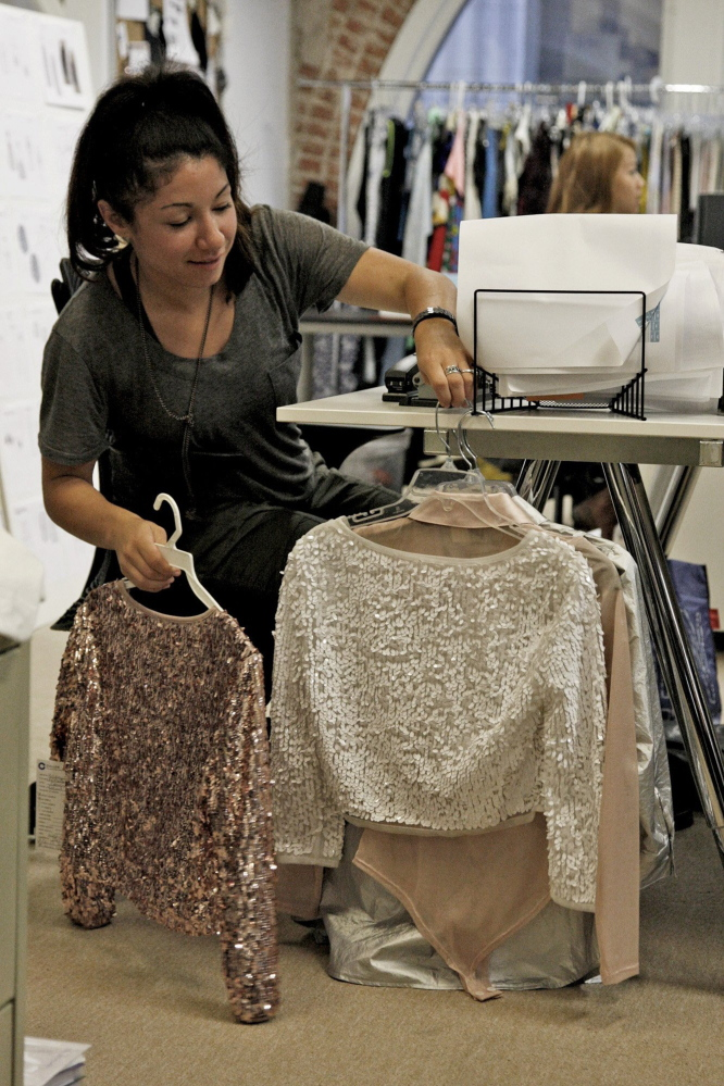 Nina Chavez, an associate technical designer for Nasty Gal, with samples at the company headquarters Los Angeles. The company, an e-commerce darling, recently announced plans to debut a brick-and-mortar shop.