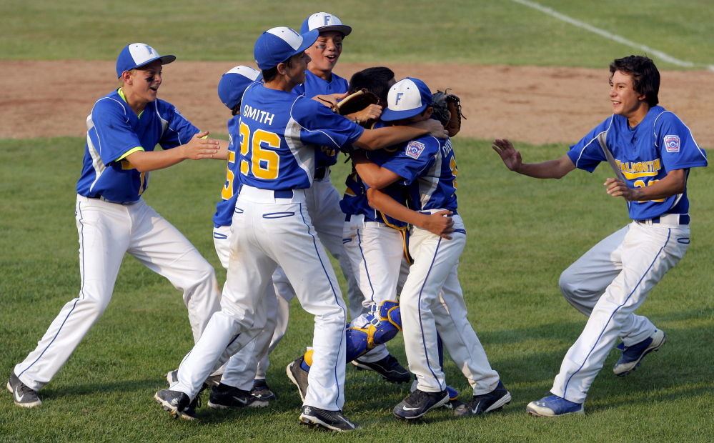 Falmouth celebrates after beating Saco 13-10 at Hill Street Field in Biddeford to win the Little League state championship Friday. Falmouth overcame a four-run deficit and then withstood a furious Saco rally late in the game. Gabe Souza/Staff Photographer
