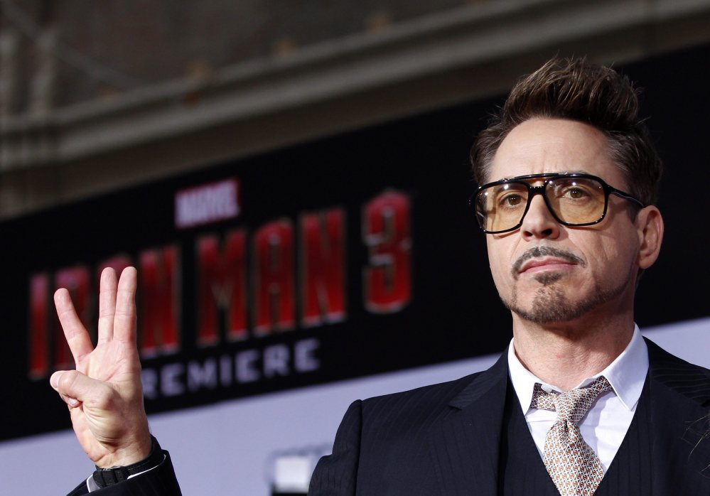 "Robert Downey Jr. poses at the premiere of ""Iron Man 3"" last year. He is the highest-paid actor in Hollywood Reuters"