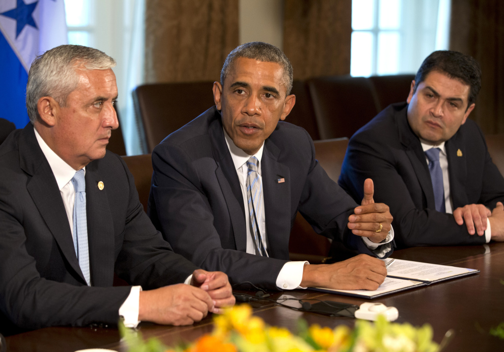 Guatemala's President Otto Perez Molina, left, and Honduran President Juan Hernandez, right, listen as President Obama speaks to the media about immigration and the border crisis, at the White House on Friday.