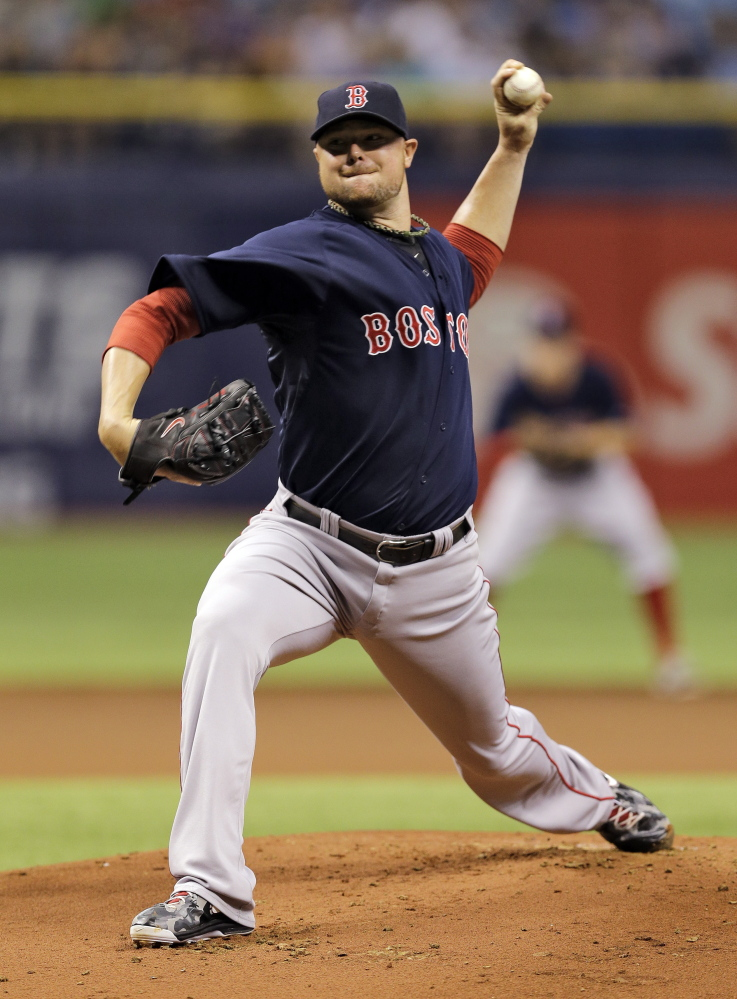 Red Sox starting pitcher Jon Lester delivers to the Tampa Bay Rays in the first inning Friday.