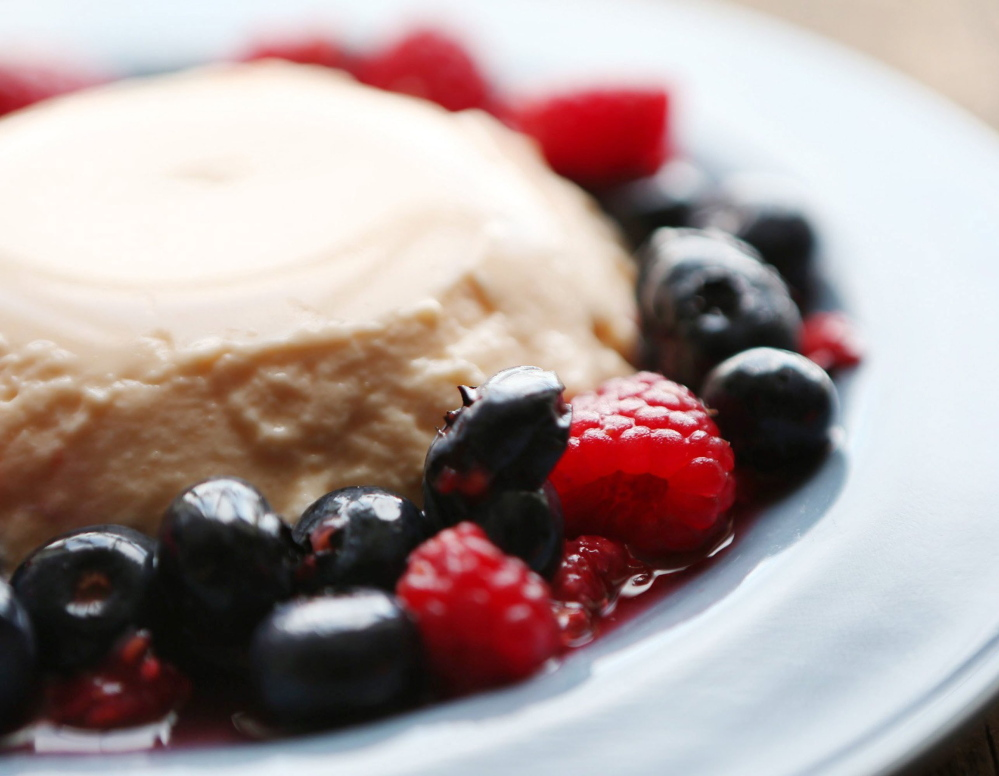 Creamy Cantaloupe Panna Cotta with Mixed Berries.