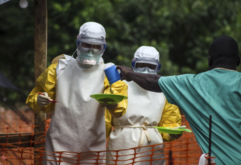 Medical staff working with Doctors Without Borders prepare to bring food to patients kept in an isolation area at an Ebola treatment center in Sierra Leone on July 20. Sierra Leone has 454 cases of Ebola, the most in the world.