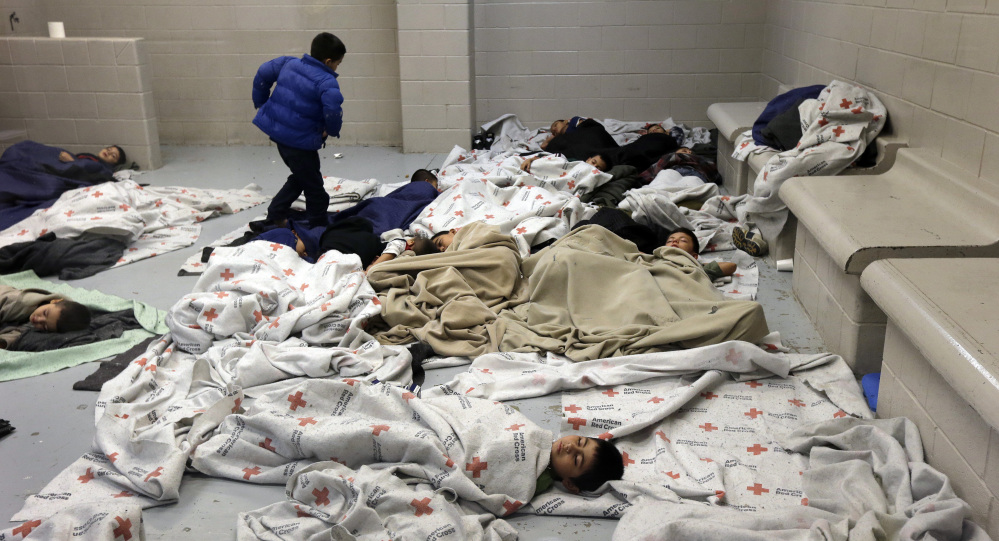 Detainees sleep in a holding cell at a U.S. Customs and Border Protection processing facility in Brownsville, Texas. A new Associated Press-GfK poll finds two-thirds of Americans now say illegal immigration is a serious problem.
