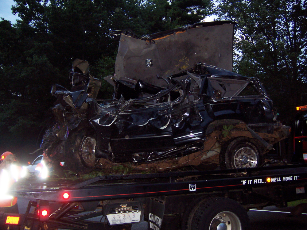 A wrecker takes away the car that crashed early Wednesday morning.