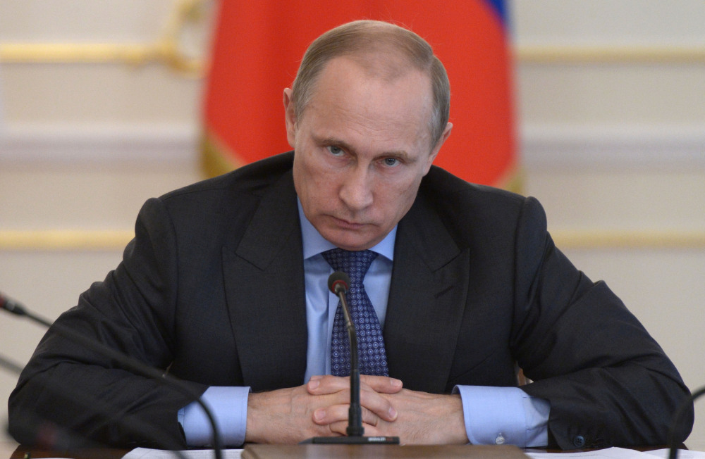 Russian President Vladimir Putin leads a Cabinet meeting Wednesday where officials discussed measures to encourage Russian companies to pull back their offshore assets.