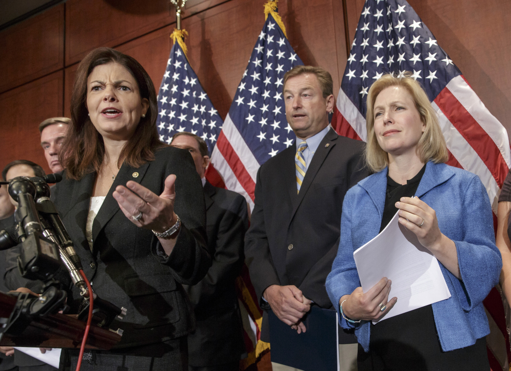 From left, Sen. Kelly Ayotte, R-N.H., Sen. Dean Heller, R-Nev., and Sen. Kirsten Gillibrand, D-N.Y., appear at a news conference on Capitol Hill in Washington on Wednesday.