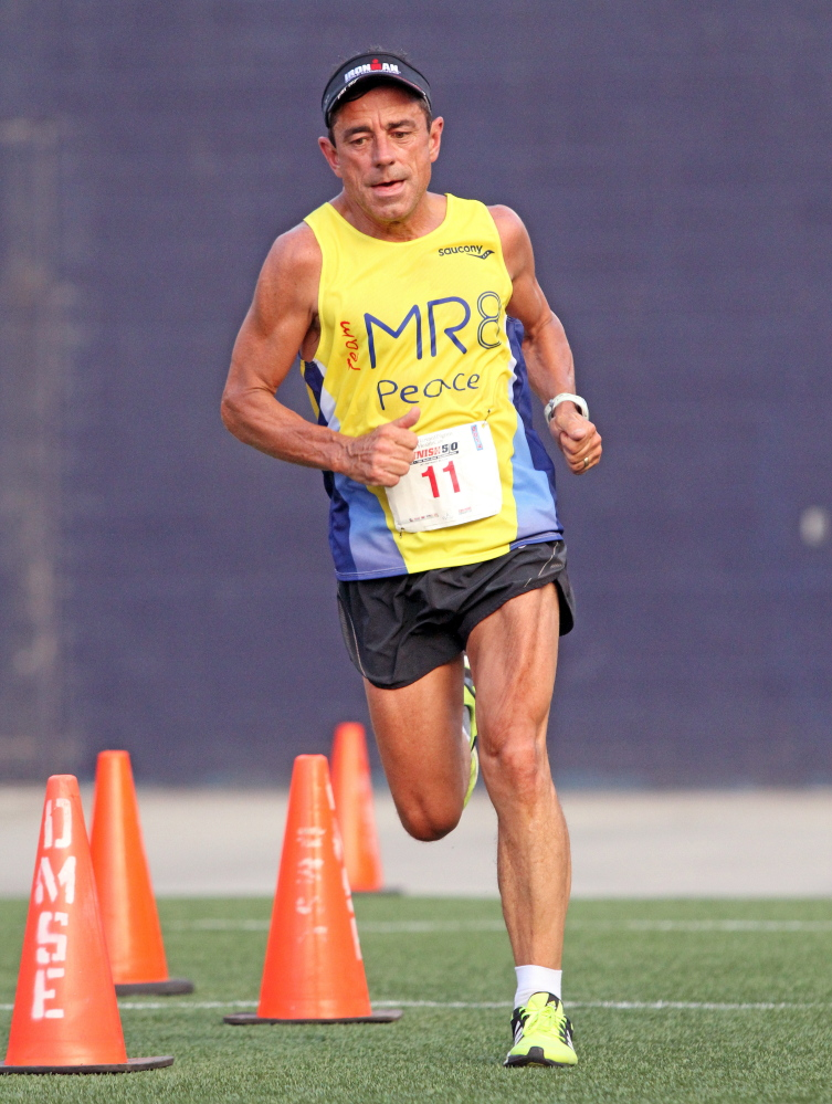 Dave McGillivray runs the Harvard Pilgrim Finish At The 50 10K last July at Gillette Stadium in Foxborough, Mass. A few months later he was shocked to learn he had coronary heart disease.