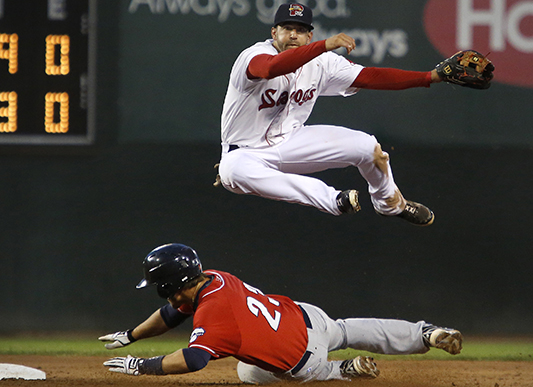 Deven Marrero of Portland leaps over New Hampshire baserunner Kevin Nolan while completing a double-play at Hadlock Field on June 24. Derek Davis/Staff Photographer