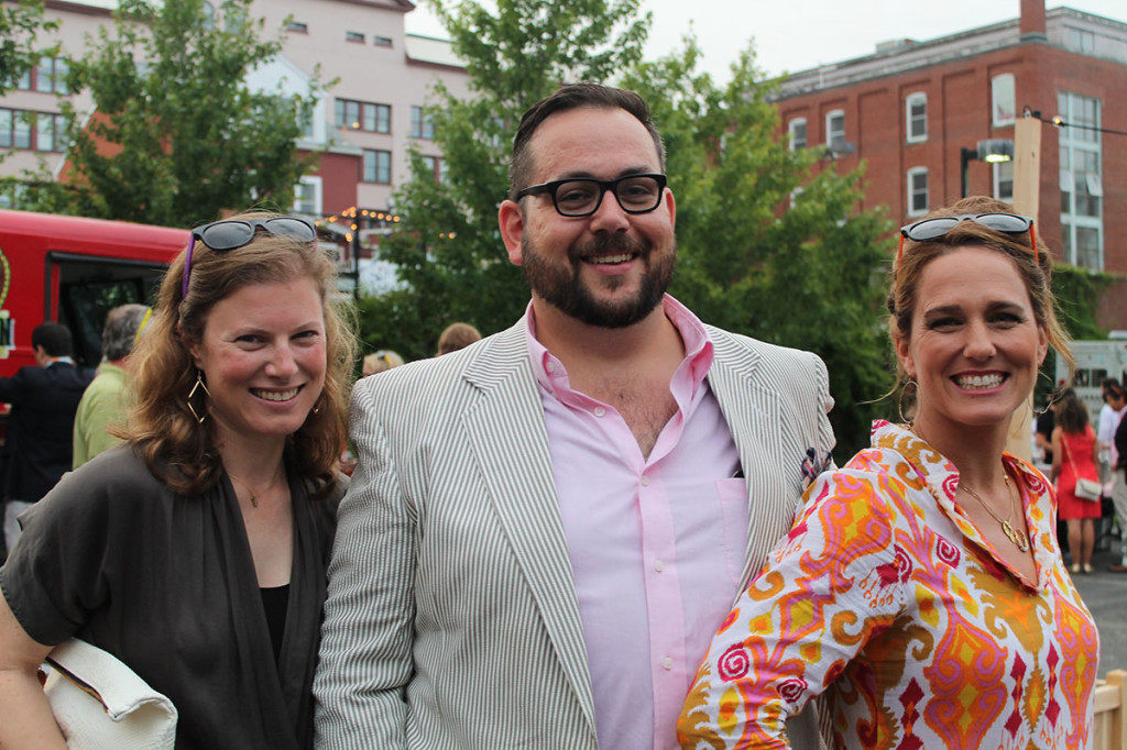 "Molly Meyer, Sean Wilkinson and MaryBeth Lorenz, members of The Contemporaries Steering Committee, take in the festivities at ""Summer in the City,"" the group's annual midsummer bash."