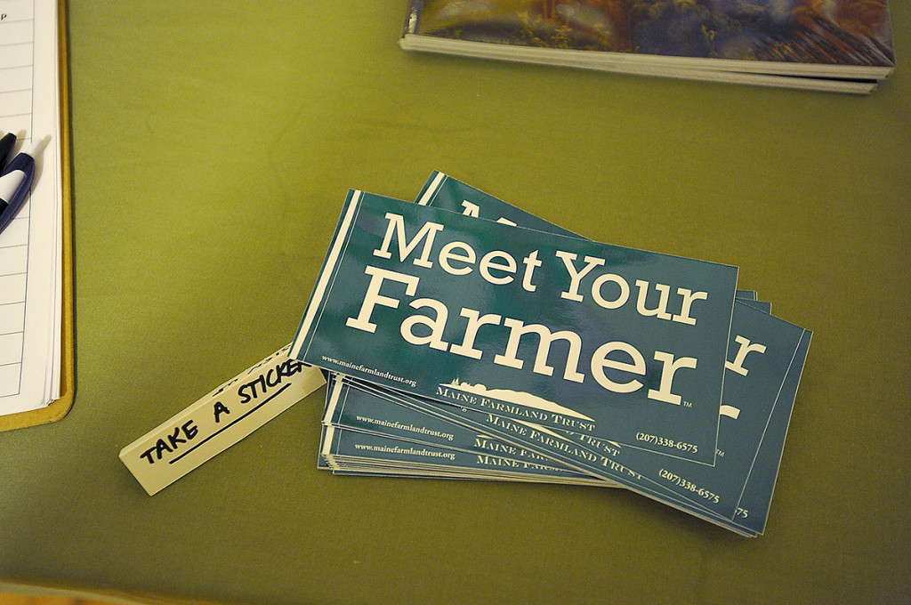 """Meet Your Farmer"" bumper stickers were available at the event."