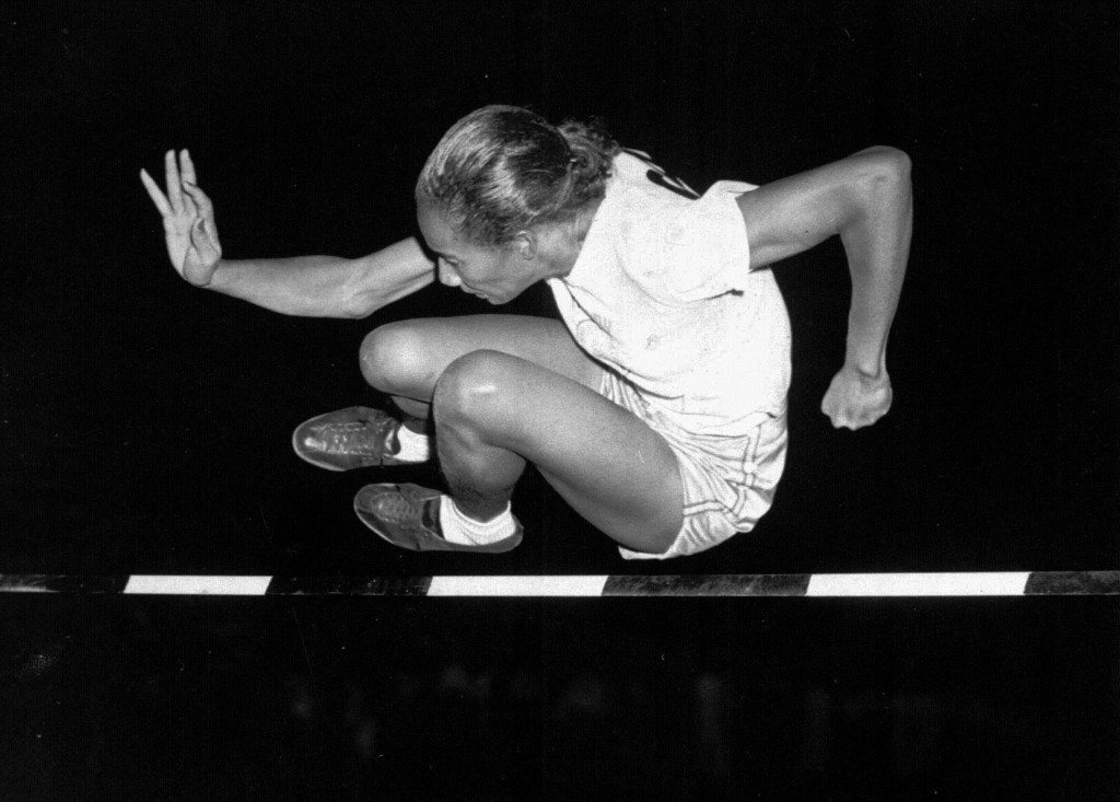 Alice Coachman of Albany, Ga., clears the bar to win the running high jump in the Women's National Track Meet in 1948 in Grand Rapids, Iowa. She is credited with helping inspire the careers of Olympians including Jackie Joyner-Kersee and Florence Griffith Joyner. File Photo/The Associated Press