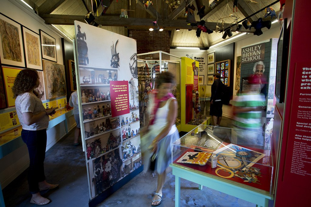 People pass through the Ashley Bryan Center at the Isleford Historical Museum on Little Cranberry Island.
