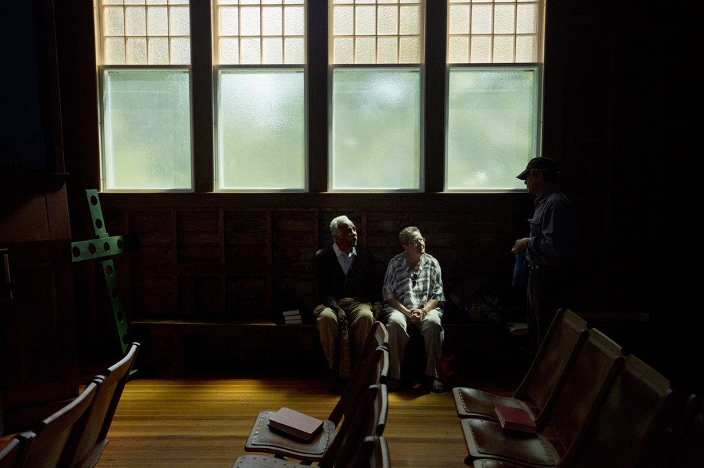 Bryan sits with Virginia Fowler, right, a professor at Virginia Tech, at the Isleford Congregational Church, as they talk to filmmaker Richard Kane. Kane is working on a documentary about Bryan, and was interviewing Nikki Giovanni, a famous poet and friend of Bryan's, for the film.