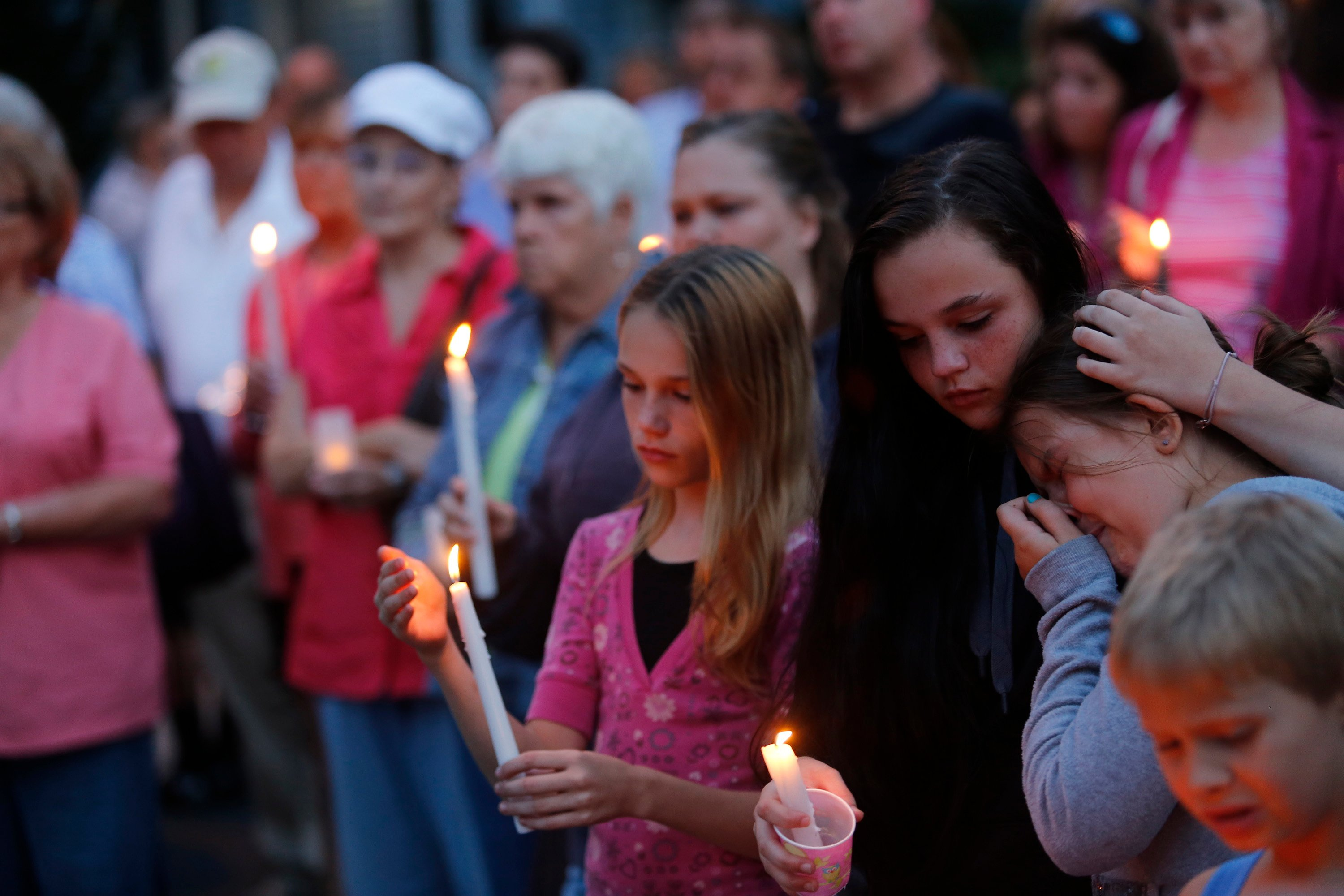 Children comfort each other during the vigil for the Smith family at the RiverView apartments in Saco.