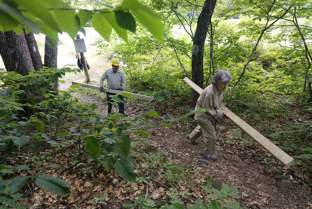 Kenway and Sanborn help construct a handicapped-accessible privy on a section of the Appalachian Trail where it crosses the Kennebec River in Caratunk.