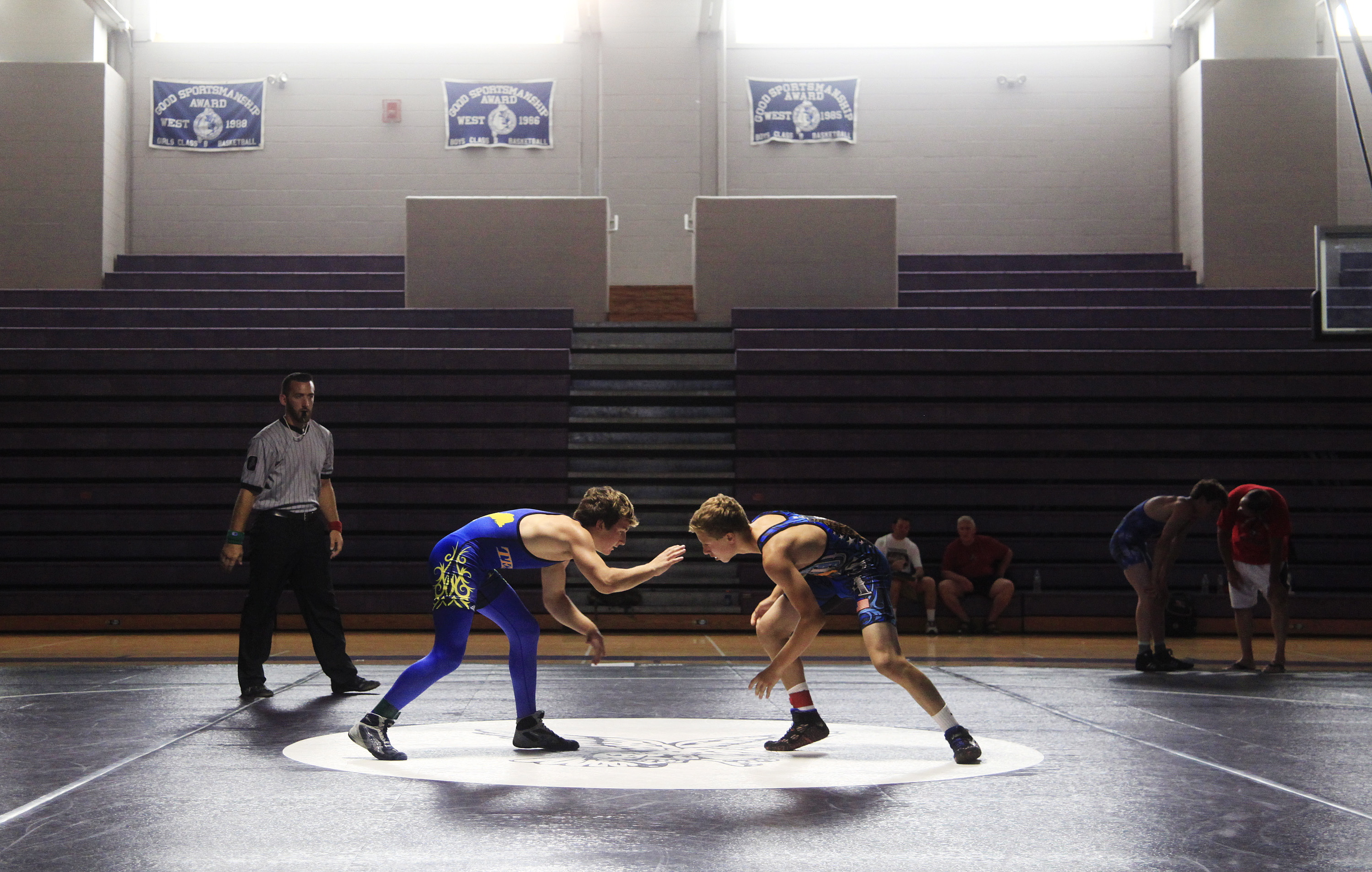 Caleb Anderson of Mt. Valley, left, and Wyatt Allan of Nebraska meet on the mat.  Jill Brady / Staff Photographer